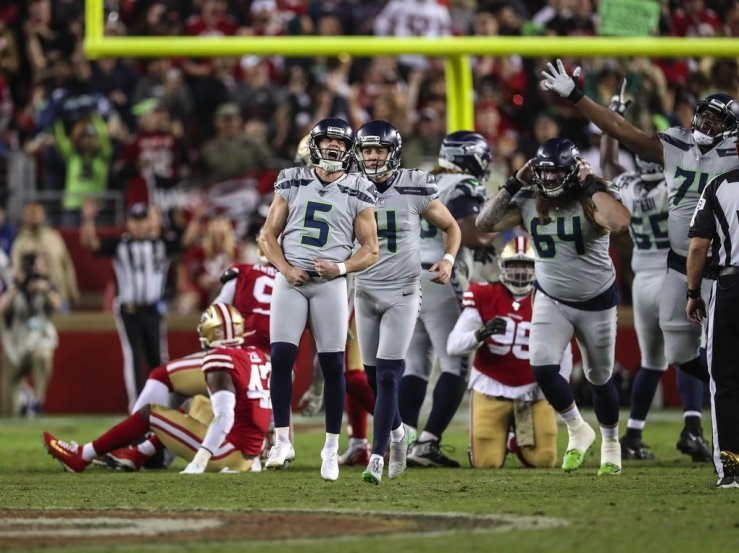 Jason Myers celebrates his game-winning field goal in overtime.